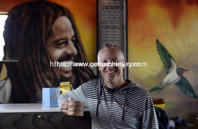 Brent Toevs CEO of Marley Coffee at his Denver office with several Marley Coffee product