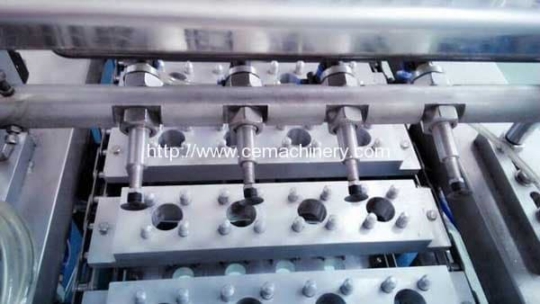 Pre-cut-foils-loading-of-linear-type-coffee-capsule-filling-sealing-machine
