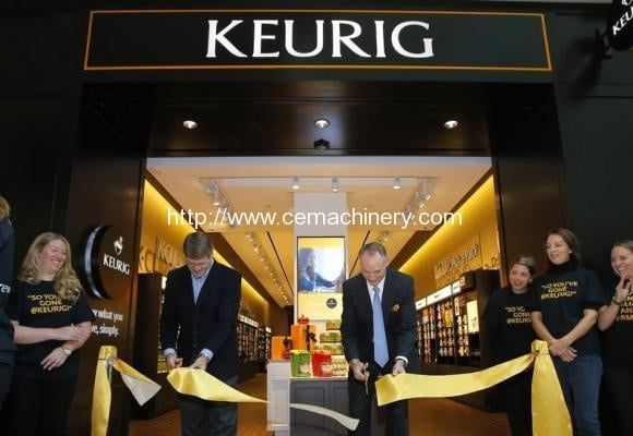 Green Mountain Roasters President and CEO Kelley and Senior Vice President Wood cut the ribbon to open the company's first Keurig retail store in Burlington