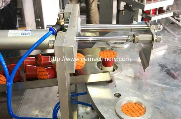 High-Speed-Rotary-Nespresso-Coffee-Capsules-Filling-Sealing-Machine-Dishcarge-Device